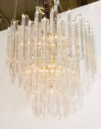 a vintage chandelier with three tiers of lucite rods suspended from a brass frame good
