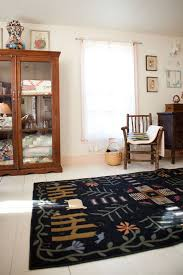 jc penny rugs with farmhouse bedroom and folk painted floor artwork vintage pale pink trim