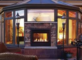 25 best ideas about indoor outdoor fireplaces on farmhouse outdoor fireplaces
