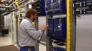 it technician works in computer server room at the laptop dude it technician works in computer server room at the laptop dude