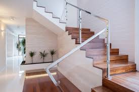 silver stair railing and wood stairs