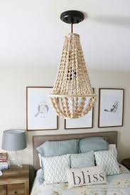 remodelaholic how to make a wood bead chandelier pertaining to new home wood beaded chandelier remodel