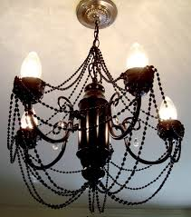 how s that for one of the coolest diy brass chandelier makeover s you ve ever seen if you have any questions or if you ve done a chandelier too