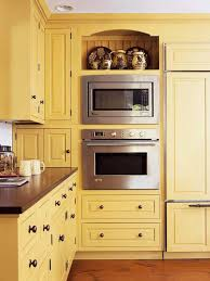 yellow cabinets with built in oven and microwave