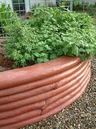 earthbag retaining wall garden beds