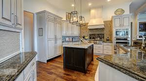 Masterbrand Kitchen Cabinets Off White Cabinets With A Dark Wood Kitchen Island Omega