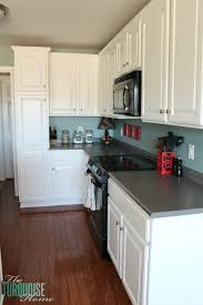 white painted cabinetsPainted Kitchen Cabinets with Benjamin Moore Simply White