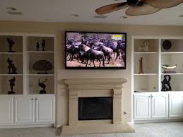 living room with tv over fireplace. Simple Tv Over Fireplace Also Decoration Terrific Living Room With Ceiling Fan And Mounting A
