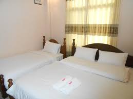 a bed or beds in a room at the garden pany hotel