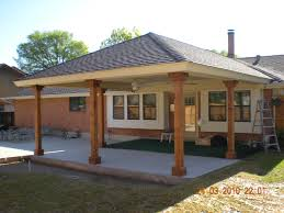 hip style patio cover with large columns