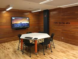 office paneling. reclaimed bleacher boards create the perfect paneling in this hudl office i