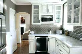 small tile backsplash small kitchen designed with white cabinets and grey subway tile small glass tile small tile backsplash