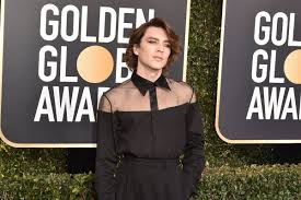 actor cody fern of american horror story apocalypse and the ination of gianni versace wears a semi sheer shirt eye makeup and curled hair at the