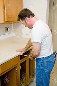 Carpenter Kitchen Cabinet Carpenter Remodeling Kitchen Is Measuring The Cabinets Focus
