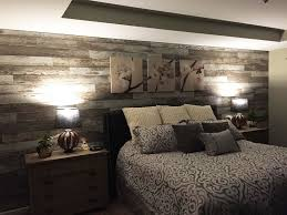 wood accent wall ideas added laminate flooring to bedroom wall to give the room a