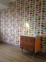 living room orla kiely multi: orla kiely multi stem wallpaper and upcycled drawers