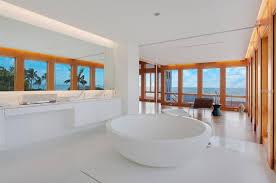 modern luxury master bathroom. Modern White Master Bathroom With Freestanding Tub, Floating Vanity And Wood-framed Glass Walls Luxury
