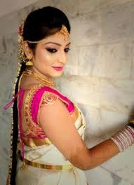 traditional southern indian bride wearing bridal hair saree and jewellery muhurat look makeup