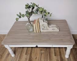 dreamy farmhouse coffee table in antique white general finishes design center