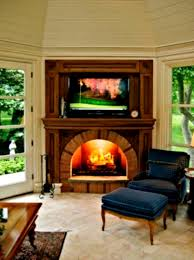stone fireplace design ideas with tv above living room varnished wood table wrought iron grate insert