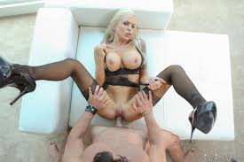Shaved Mature Blonde MILF Nina Elle with Tattoo Wearing Black.