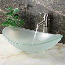 bowl bathroom sink featuring cool dark vanity