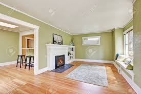 living room interior design of craftsman home with white brick fireplace built in shelves
