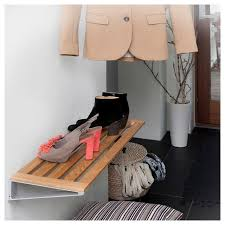 wood shelf for shoes in hall way
