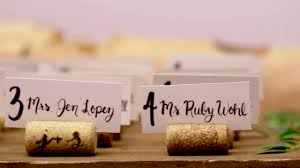 diy wine cork place card holders for your wedding