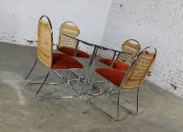 mid century daystrom round glass and chrome dinette table and four chrome and wicker chairs