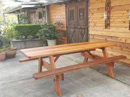 outdoor furniture at cherry tree hill winery two wooden outdoor picnic tables