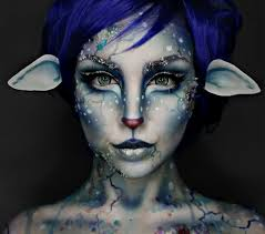 artist this blue hued deer like face makeup design is brilliant can t stop staring at it