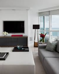 furniture living room wall: slick textures in this modern living room include minimalist wood media center and off white