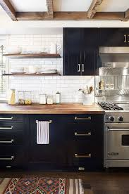 pairing these elements with a sleek yet classic butcher block countertop gives the space a