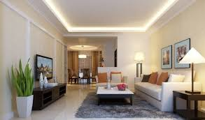 Stylish Sitting Room with False Ceiling Designs above White Sofas and  Stylish Coffee Table