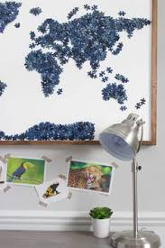 how to repurpose old puzzles with missing pieces into a beautiful statement piece of map wall art includes tips on two methods for attaching the stained  on puzzle into wall art with forever in the making how to frame a puzzle life hacks diy