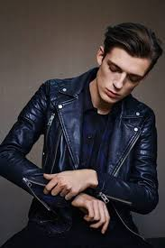 look at this amazing leather moto jacket with a combination of black jeans and blue striped shirt gear up with a vintage look