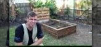 a raised garden bed out of old pallets