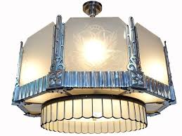 chandelier and matching ceiling fans for this is a matching set of three art deco lamps if you collect early brass