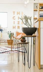 these side tables cabn be used as freestanding planters plant holders i love the black metal legs with a rustic wood top