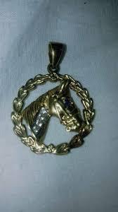 stunning 9ct gold horse head pendant