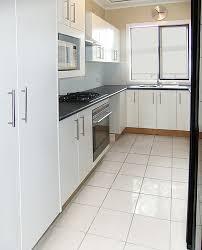 White tile flooring kitchen Popular Kitchen Tile Floor White Victorian Floor Tile Designs On Design Ideas For White Kitchens Morespoons Victorian Floor Tile Designs On Design Ideas For White Kitchens