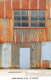how to rust corrugated metal old lamp in warehouse rusted corrugated metal wall of a warehouse how to rust corrugated metal