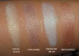 here are swatches of the 4 highlighters applied wet i used mac fix