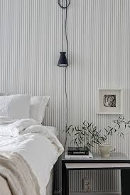 Stripes in the bedroom of a soothing Swedish space