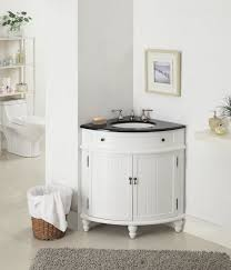 corner bathroom cabinet in small size with white color completed with round sink and double lever