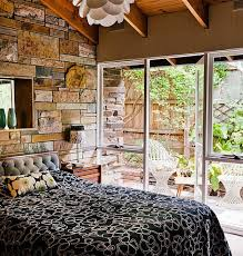 Bedroom. Brown Stone Wall Added By Black Bed Sheet And Glass Wall . Eye