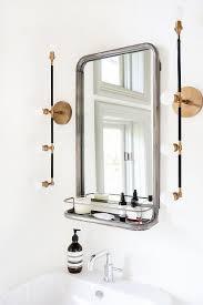 modern bathroom sconce lighting. modern bathroom features a restoration hardware astoria mirror with shelf illuminated by brass linear sconces, apparatus studio vanity ove\u2026 sconce lighting
