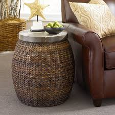 hammary treasures round driftwood accent table woven ratten wicker base with a metal frame for stability wood top casual style 325