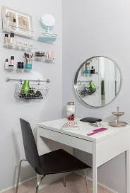 a functional makeup space with a micke desk a comfy chair some wall